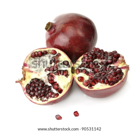 Ripe Pomegranate With Red Seeds On White Background ,Close Up - stock photo