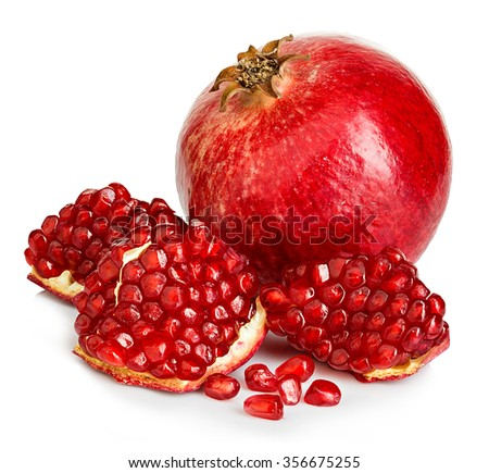 Ripe pomegranates close-up on a white background. - stock photo
