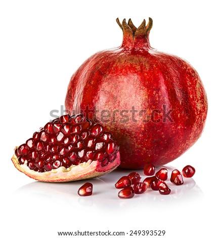 Ripe pomegranates isolated on a white background. - stock photo