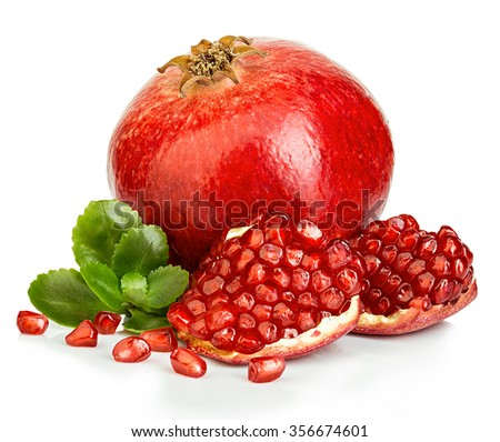 Ripe pomegranates with leaves close-up on a white background. - stock photo