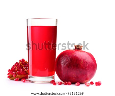 ripe pomergranate and glass of juice isolated on white - stock photo