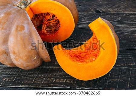 Ripe pumpkin, sliced pumpkin, pumpkin on the table, sliced pumpkin on the table - stock photo