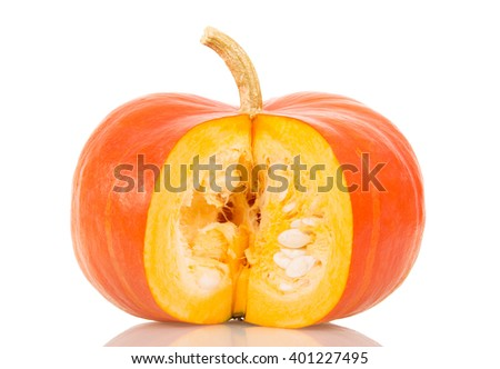 Ripe pumpkin with a carved piece isolated on white background. - stock photo