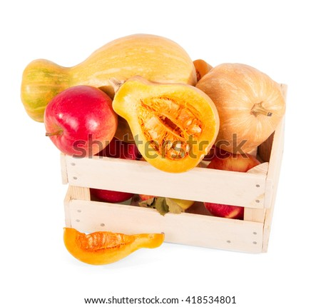 Ripe pumpkins and apples in a wooden box isolated on white background. - stock photo