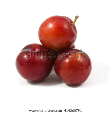ripe purple cherry plums isolated on white