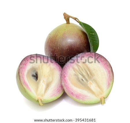 Ripe purple star apple fruit with half isolated on white background - stock photo