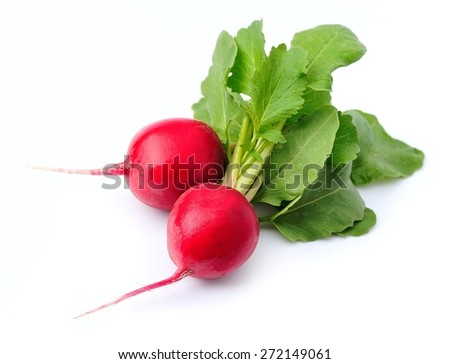 Ripe radishes with leaves close up on white background.  - stock photo