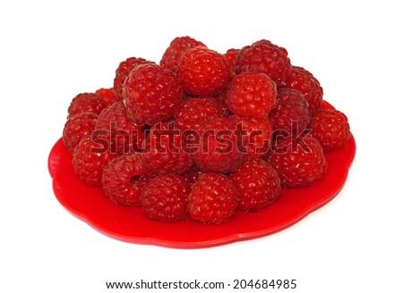 Ripe raspberries in a small platter                                - stock photo