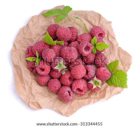 Ripe raspberry with green leaves - stock photo
