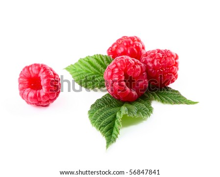 Ripe raspberry with green leaves over white - stock photo