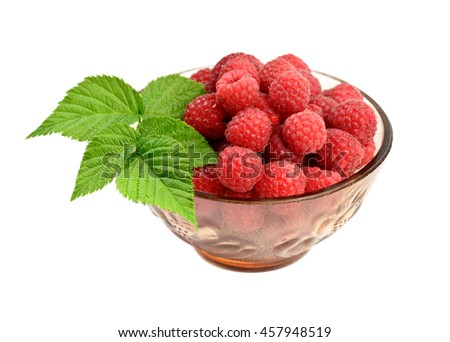 Ripe raspberry with leaf at bowl on white background - stock photo
