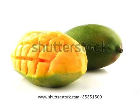 ripe raw mango served over white background - stock photo
