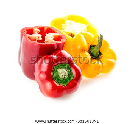 Ripe red and yellow capsicums ready have seeds removed - stock photo