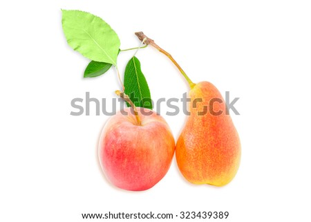 Ripe red and yellow European pear and red apple with leaf on a light background. Isolation. - stock photo