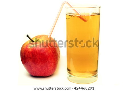 ripe red apple and apple juice on a white background
