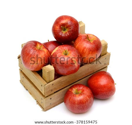 Ripe red apple fruits in a wooden box isolated on a white background