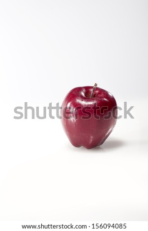 Ripe red apple. Isolated on a white background