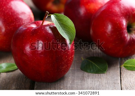 Ripe red apples on table close up - stock photo
