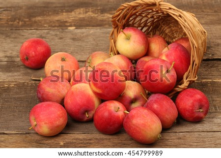 Ripe red apples on wooden background - stock photo