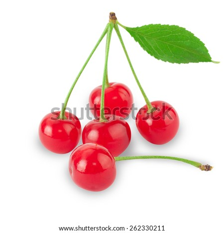 Ripe red cherry berries with green leaves - stock photo
