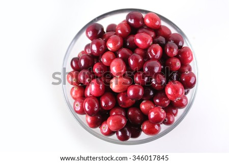 ripe red cranberries in glass bowl top view - stock photo