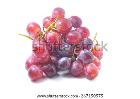 Ripe red grapes on white background - stock photo