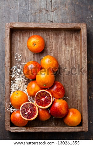 Ripe red oranges on textured background - stock photo