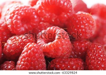 Ripe red raspberries close up - stock photo