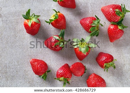 Ripe red strawberries on stone table, top view - stock photo
