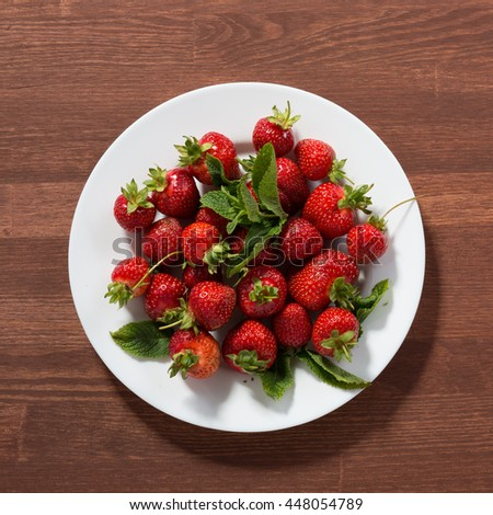 Ripe red strawberries on wooden table. Strawberry. Fresh strawberry. Red strawberry. Strawberry Juice. Loosely laid strawberries in different positions. - stock photo