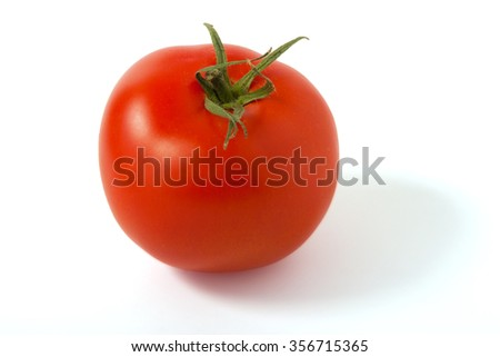 Ripe red tomato on a white background, clipping path.