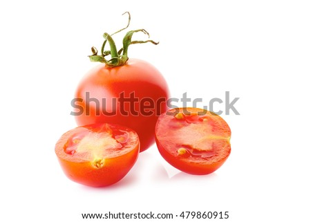 Ripe red tomatoe with two slices on white