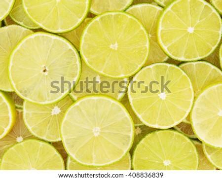 Ripe sliced limes - stock photo