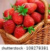 Ripe strawberries in a basket - stock photo