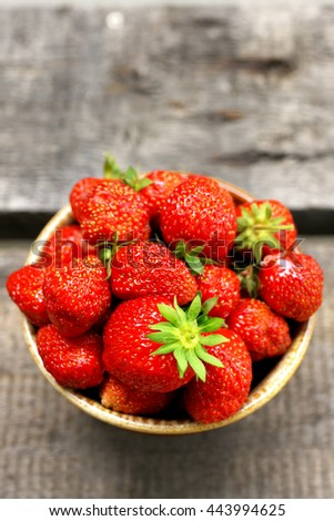ripe strawberries in an earthenware bowl - stock photo