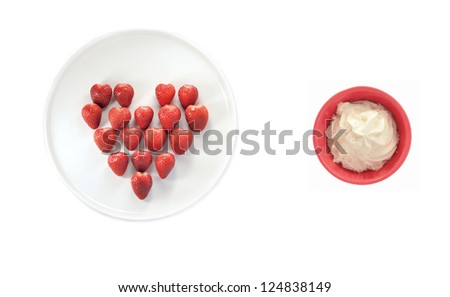 Ripe strawberries laying in a heart shape and whipped cream - stock photo