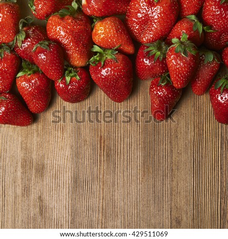 ripe strawberries on wooden table. top view. header. - stock photo