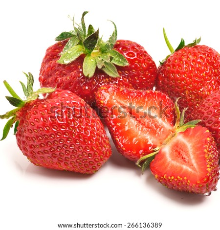 Ripe strawberries with leaves isolated on the white background - stock photo