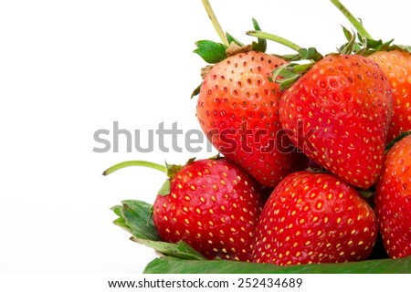 Ripe strawberries with leaves on a white background - stock photo