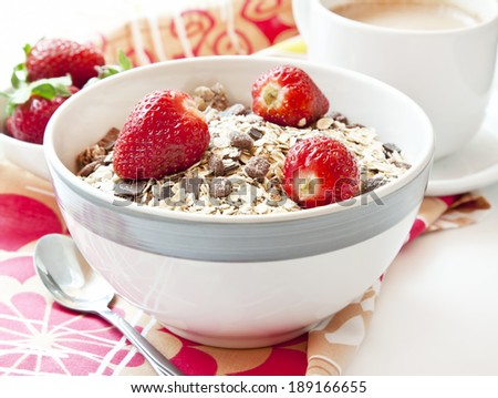 Ripe Strawberries with Muesli in a Bowl, Healthy Breakfast - stock photo