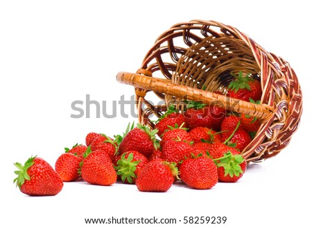 Ripe strawberry in wicker basketbasket isolated on a white background - stock photo