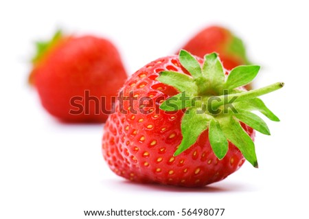 Ripe strawberry isolated on a white background - stock photo