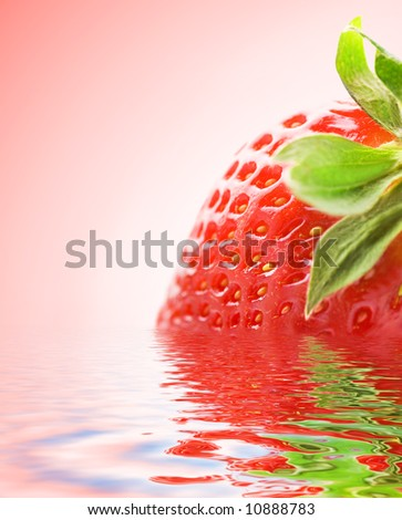 Ripe strawberry reflected in rendered water - stock photo