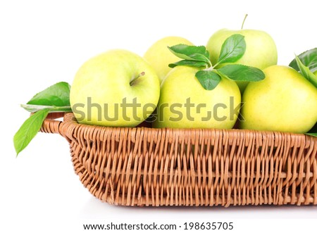 Ripe sweet apples with leaves in wicker basket, isolated on white - stock photo