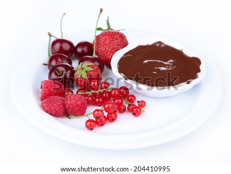 Ripe sweet berries and liquid chocolate, isolated on white