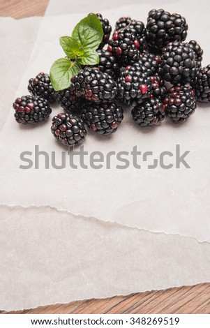 Ripe sweet blackberries on wood table background - stock photo