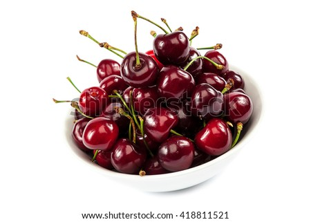 Ripe sweet cherries in a bowl isolated on white background. - stock photo