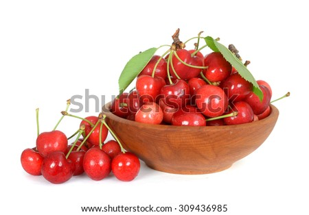 ripe sweet cherry on wooden bowl  on white background