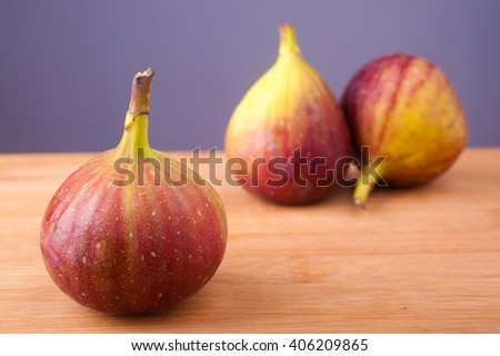 Ripe sweet figs on wooden table. - stock photo