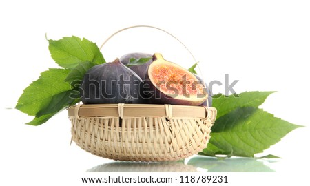 Ripe sweet figs with leaves in basket isolated on white